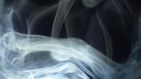 puffs : abstract motion of white smoke in light on a black background Stock Footage