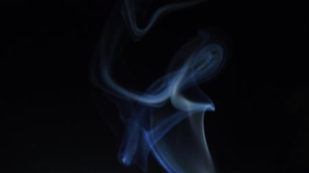 marmorizado : blue smoke rises on a black background