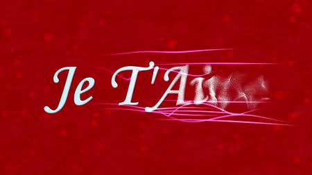 t'aime : I Love You text in French Je TAime formed from dust and turns to dust horizontally with moving stripes on red animated background