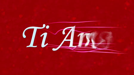 ambição : I Love You text in Italian Ti Amo formed from dust and turns to dust horizontally with moving stripes on red animated background