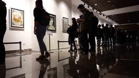 művésziesség : Eskisehir, Turkey - March 4, 2017: People visiting Salvador Dalis Les Songs Drolatiques de Pantagruel Exhibition in Contemporary Art Gallery