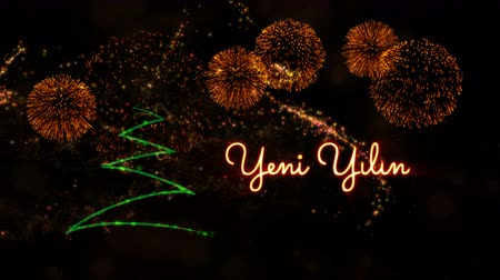 fade in : Happy New Year text in Turkish Yeni Yiliniz Kutlu Olsun animation over pine tree with sparkling particles and fireworks on a snowy background
