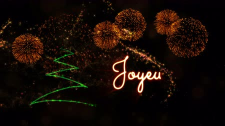 fade in : Merry Christmas text in French Joyeux Noel animation over pine tree with sparkling particles and fireworks on a snowy background