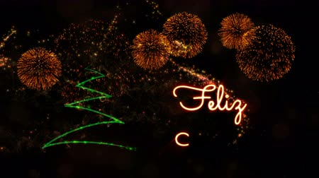 fade in : Merry Christmas text in Spanish Feliz Navidad animation over pine tree with sparkling particles and fireworks on a snowy background