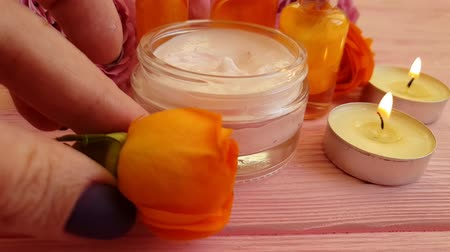 beauty products : rose cream candle time lapse Stock Footage