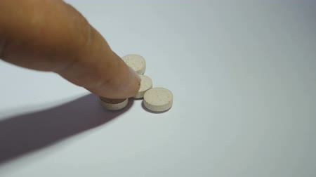 impaired : Man counting pills closeup Stock Footage