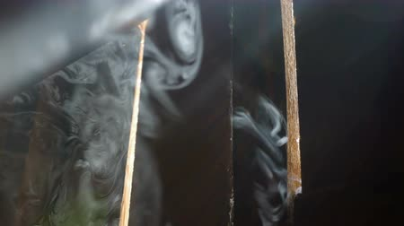 charred : smoke goes through holes in the boards Stock Footage