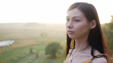 hayloft : young beautiful woman at sunset slow motion