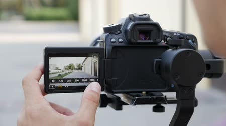 operators : filmmaker takes video with DSLR Camera on the Gimbal