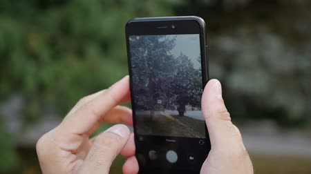 mirror less camera : filmmaker takes video with mobile phone