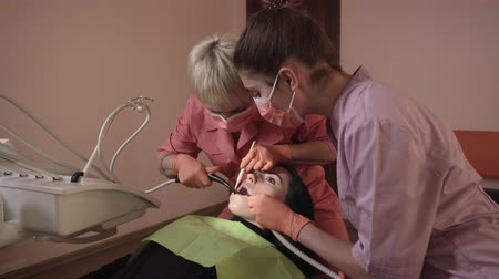 surgical light : Dentist Examines And Heals The Teeth Of A Young Woman. Dentist Using Tools, Equipment And Instruments In The Dental Office.