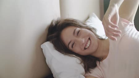 宿泊施設 : Young Beautiful Woman Wakes Up In The Morning. Sun Rays Fall On Her Face. Close Up.