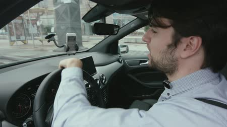 Young Man Is Driving A Car And Use Your Smartphone
