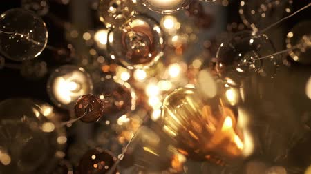 luster : Expensive Large Chandelier Of Glass In A Restaurant Or Concert Hall, Shot With Blurred Focus And Reflections. Chandelier Lighting In Hall, Bokeh, Glare, Glow, Defocus. The Video Is Suitable For The Background. Luxury Life.