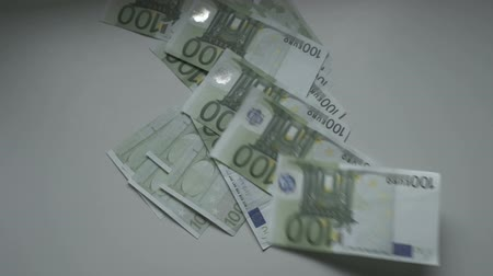 euro banknotes : Slow motion Euros Are Falling On The Table