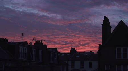 Roze zonsondergang in Londen Stockvideo