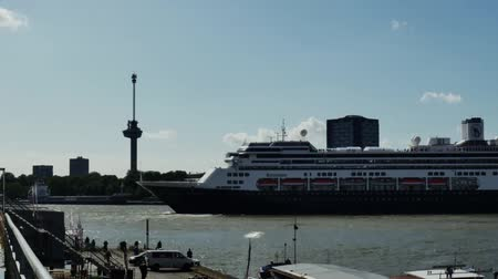 deep seaport : A large ship detaches from the shore in the port city of Rotterdam Stock Footage