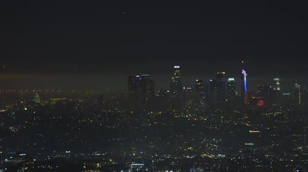 finale : Salutes Los Angeles. Night city. Beautiful view of the best megapops. From the height in the dark you can see modern skyscrapers and new tall buildings.