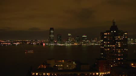 a View of the Huge City of New York. Sunset on the Horizon and the Ensuing Darkness. Dostupné videozáznamy