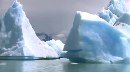 View of the White Icebergs of Antarctica. Overlooking the Water Icebergs. Dostupné videozáznamy