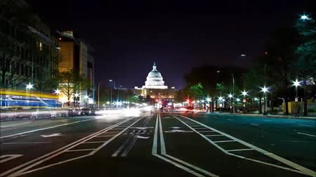 Night road in the US. By way of visible capitol. On the way Ride car with headlights included.