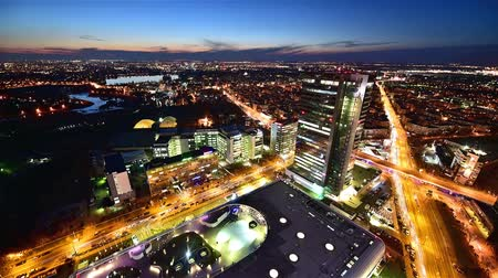 Night Bucharest Birds-Eye View. View of The City From on High. on the Road Going Car With Headlights Included. Dostupné videozáznamy