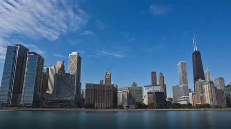 john : View of Chicago Skyscrapers. Buildings of Different Shapes and Heights Facing the River.