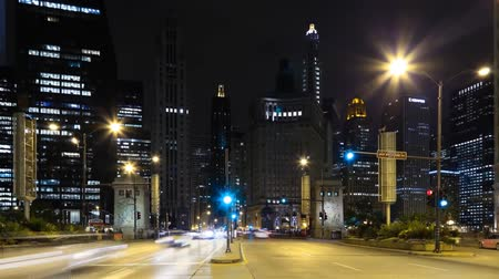 view of the Chicago way. At night-time on the road going cars