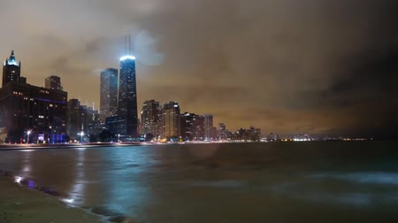 views of the waterfront from chicago heights. Night lights illuminate the city