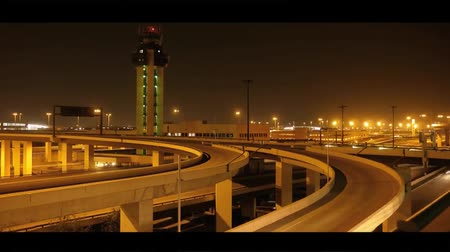 a View of The Dallas Night Road Not Far From The Airport. on the Road Going Car With Headlights Included. on Top of the Road Cross the Bridges Dostupné videozáznamy