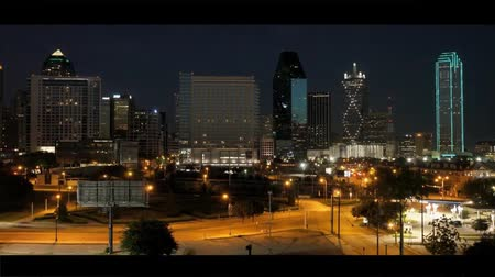 Dallas on The Road Are Illuminated by Night Lights. on the Road Going Car With Headlights Included.