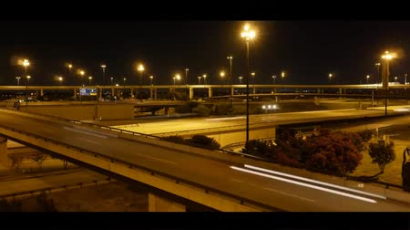 Great Road Interchange in Dallas. on The Road Going Car With Headlights Included. on Top of the Road Cross the Bridges.