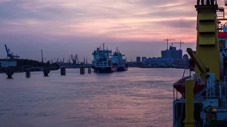 Sunset in the Port of Hamburg. the Sun Sets Over the Horizon and Darkness Falls. For Water Sailing Ship Dostupné videozáznamy