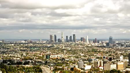 los angeles skyline : Los Angeles in Cloudy Weather. The Clouds Float Across the Sky and Cast Its Shadow Over the City. a View of the Wide Road, the Road Goes a Lot of Cars Stock Footage