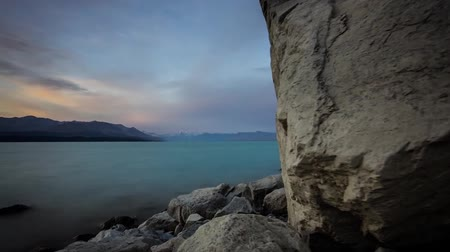 marian : a Large Blue Lake in New Zealand. The Waters of the Lake Through a Large Stone. Stock Footage