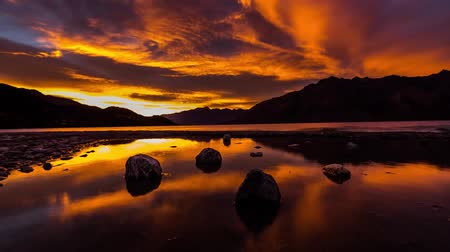 marian : Red Yellow Clouds Floating Over The Lake in The Mountains of New Zealand.