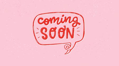 Animated Coming Soon hand drawn lettering text in speech bubble outline on the pink pastel background. Motion graphic with red letters for ad of a new product. Moving inscription for icon, e-shop, store Stock mozgókép