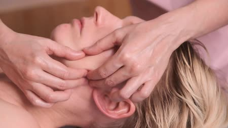main : Spanish facial massage. Close-up of a young caucasian woman getting a treatment at the spa salon. Slow motion Stock Footage