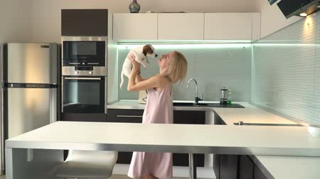 Woman playing with his dog at home Wideo