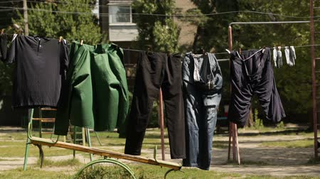 Laundry drying on clothesline on sunny street