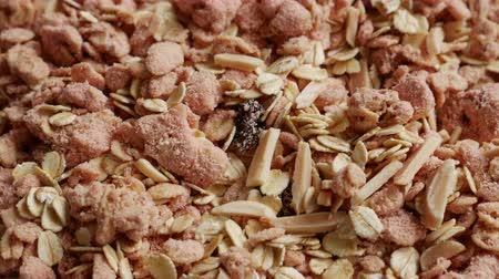 otruby : Close up of Strawberry Granola Oat Cereal textured with Almond and Raisin for Healthy Breakfast and Snack.