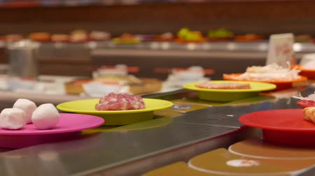 hotpot : Conveyor Belt Shabu Shabu hotpot transporting food and ingredients in restaurant Stock Footage