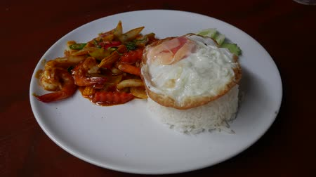 chilli sauce : Dish of Stir Fried seafood with Red Curry Paste with cooked rice and Fried egg. Thai food.