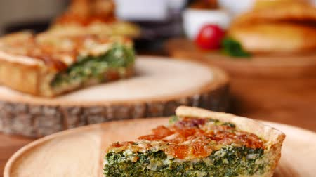 quiche : Quiche a savoury open tart or flan consisting of pastry crust with spinach mushrooms cheese. Stock Footage