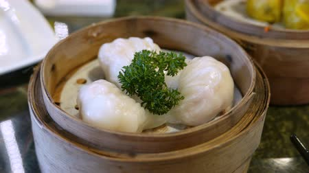 bamboo steamer : Ha gow a shrimp dumplings is a traditional Cantonese dumpling served in dim sum.