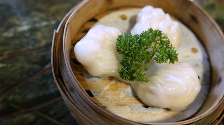 bamboo basket : Ha gow a shrimp dumplings is a traditional Cantonese dumpling served in dim sum.