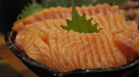 seafood dishes : salmon sashimi or Raw salmon slice. Japanese cuisine.