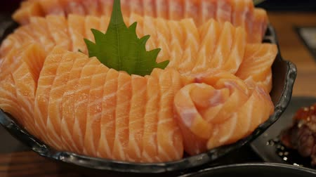omega : salmon sashimi or Raw salmon slice. Japanese cuisine.
