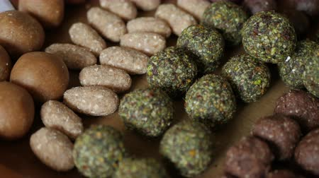 yermantarı : Healthy snack Organic Dates oatmeal energy balls with green tea, Cocoa, Nuts. Stok Video