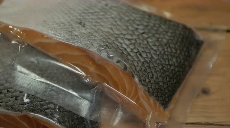 omega : Fresh Norwegian Salmon fillet packaging in seal Vacuum pouch.